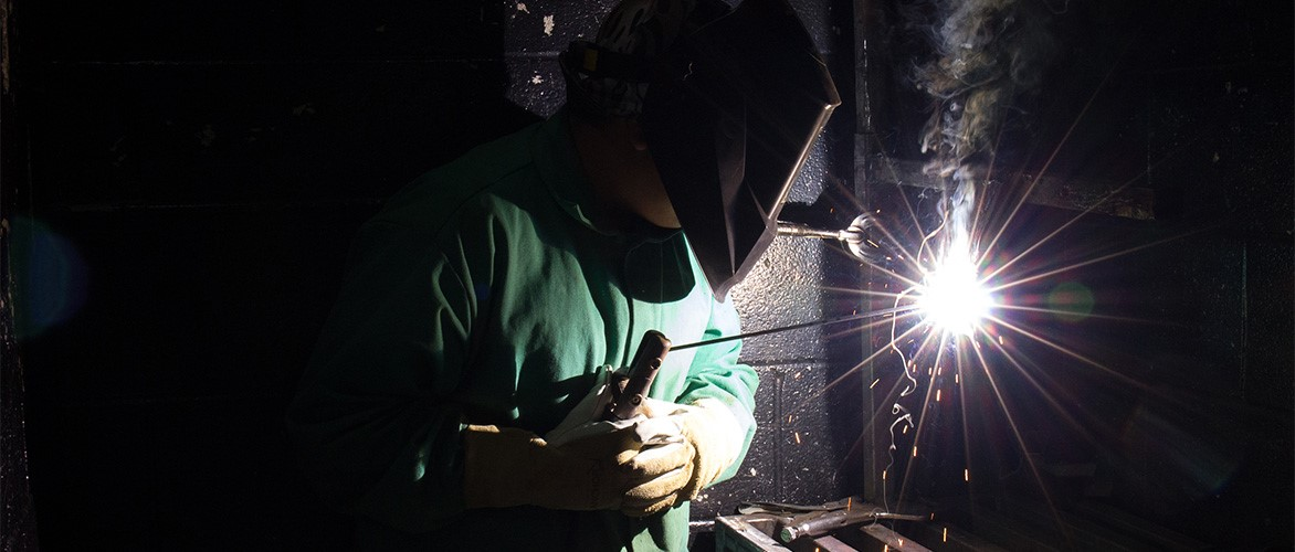 Student demonstrating a welding process.