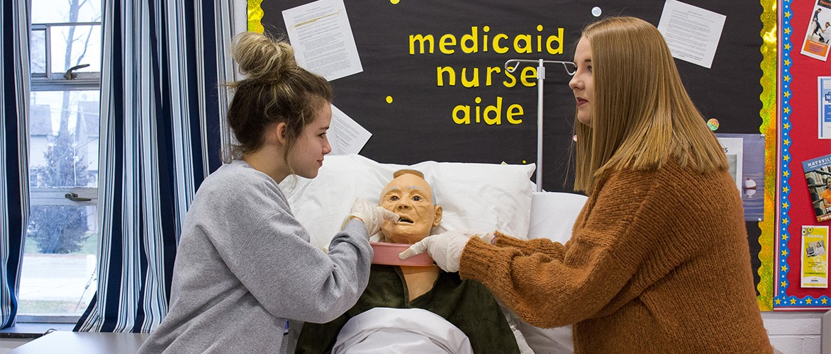 Students demonstrate patient care in the Health Sciences program.